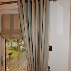 eyelet curtains and roman blinds